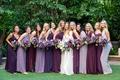 wedding portrait bride in marchesa wedding dress and bridesmaids in purple dresses matching bouquets