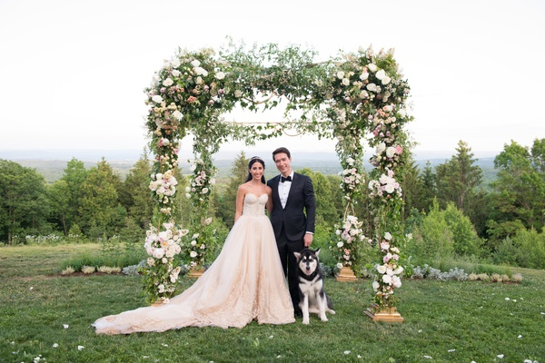 groom in Ermenegildo Zegna, bride in custom Mark Ingram blush gown, husky dog