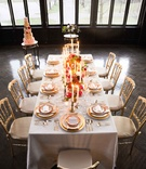 white gold tablescape pops of color vintage wedding styled shoot inspiration candles cake hempstead