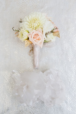 Bouquet of white mums, golden leaves, pink roses bound in fabric with silver glitter for bridesmaid