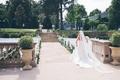 Bride walking through chairs to meet groom