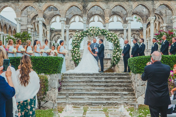 the ocean club, four seasons bahamas wedding ceremony in front of the cloisters