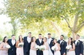 wedding party smiling outdoors pink dresses blue suits bouquets trees california wedding