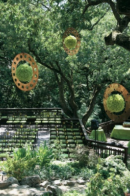 Backyard wedding ceremony surrounded by trees
