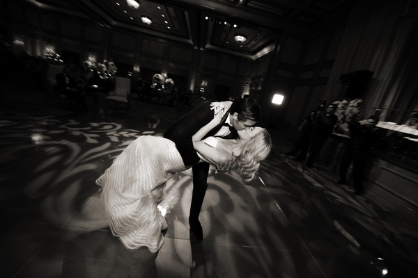 Black and white photo of couple's first dance kiss