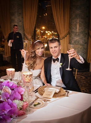 newlyweds bride and groom toast champagne the drake gold coast room