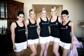 Bridesmaids in black tank tops getting ready