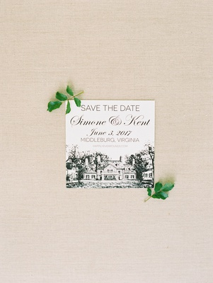 save the date with drawing of venue and wedding website