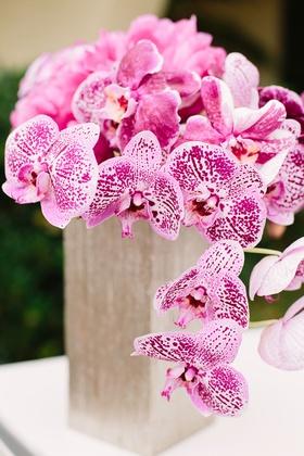 pink purple orchids floral arrangements centerpieces tan vase
