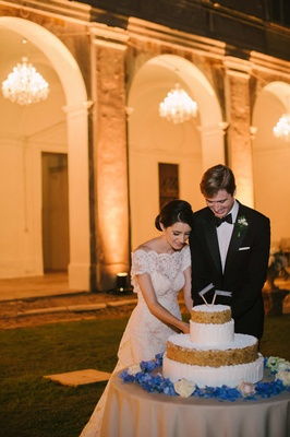 bride and groom cut italian wedding cake