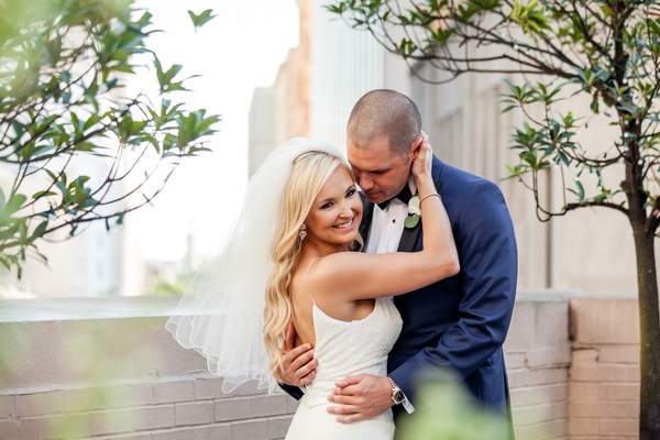 bride in blush by hayley paige, groom in navy tuxedo