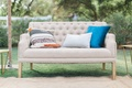 outdoor lounge space gray couch colorful pillows california winter wedding styled shoot boho ranch