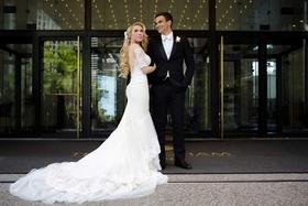 bride in galia lahav wedding dress low back half sleeves long blonde hair groom in tuxedo white tie