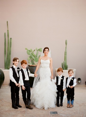 Adrianna Costa with four ring bearers in bolo ties