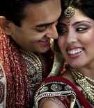 Indian bride and groom in lengha and sherwani