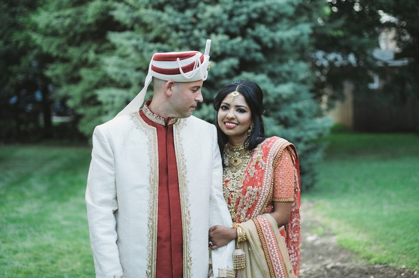 South Asian bride and Irish groom in sherwani and lehenga
