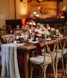 fall wedding inspiration velvet burgundy napkins peach white & pink flowers sheer grey table runner