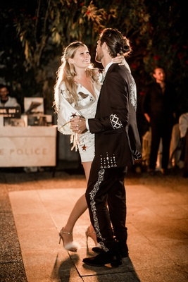 bride in minidress with star motif and groom in embroidered suit for first dance at villa lake como