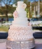 Ivory fondant cake decorated with rosebuds