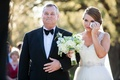 Bride in Nardos Iman wedding dress with belt and rustic bouquet with father of bride in bow tie