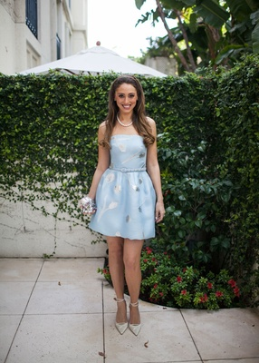 Bride at bridal shower in light blue strapless cocktail dress with silver pattern