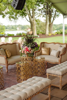 antique vintage inspired furniture and gold tables tufted lounge wedding reception