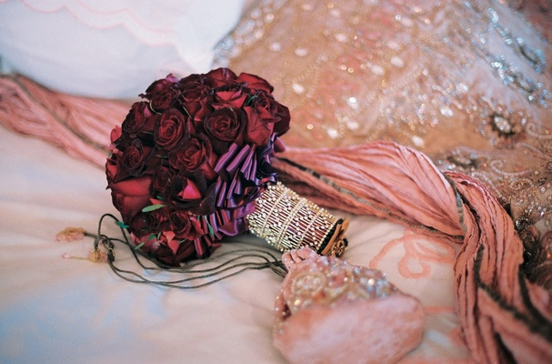 Burgundy roses and pink velvet wedding purse