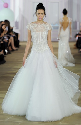 Soft tulle ball gown with boat neck lace and pearl corset bodice, basque waist and cap sleeve.