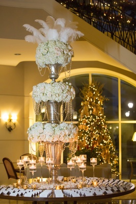 grand escort card table florals feathers north carolina wedding crystals candles christmas tree