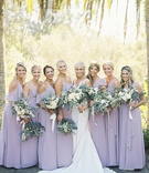 bride in pronovias wedding dress, bridesmaids in joanna august bohemian rhapsody dusty lavender