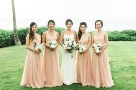 Wedding portrait bride with bridesmaids peach apricot bridesmaid dresses montage kapalua bay lawn