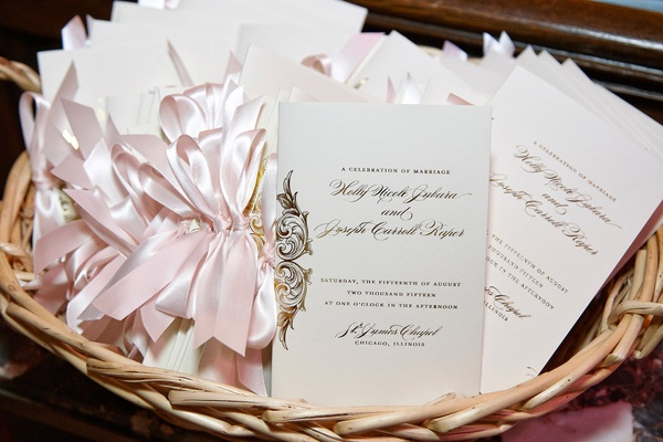 ivory wedding program basket with gold writing and light pink ribbon