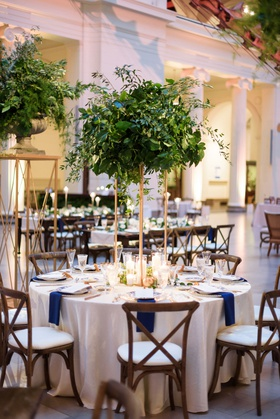 wedding reception the field museum greenery on gold stand wood vineyard chair blue napkins round