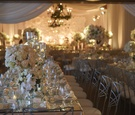 Table with mirror topped with neutral centerpieces