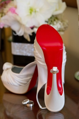 Solitaire diamond engagement ring on Louboutin heel