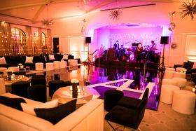 wedding reception ballroom for dancing purple pink lighting monogram dance floor black white lounge