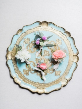 Bohemian Inspired Boutonnieres Placed On Ornate Plate