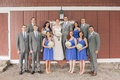 Bridesmaids in blue and groomsmen in grey