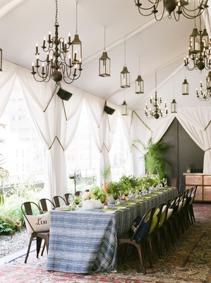 bridal shower moroccan rugs blue white linens industrial chairs place card pillows lanterns drapery