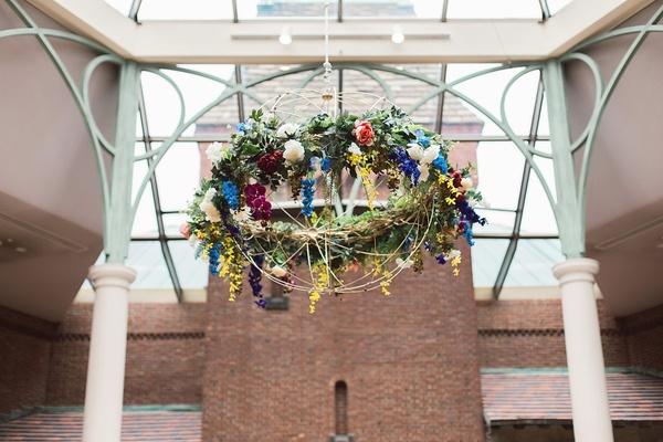 colorful floral fixture suspended over reception art institute of dayton ohio unique flowers vintage