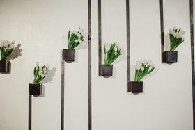 black box vase on wall with white tulips and black lines, modern wedding decor