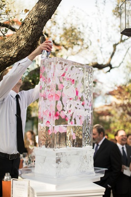 wedding cocktail hour ice luge custom design couple's names pink flower petals signature cocktail