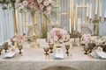 champagne taupe tablescape featuring tall low pink rose florals gold candelabra different sizes