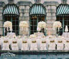 Nuage Designs gold interlace accessories on chair covers long head table orchid centerpieces