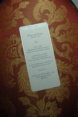 Silver scroll design on white wedding menu card