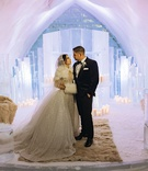 bride and groom portrait ice castle wedding chapel snow floor faux fur rugs throws