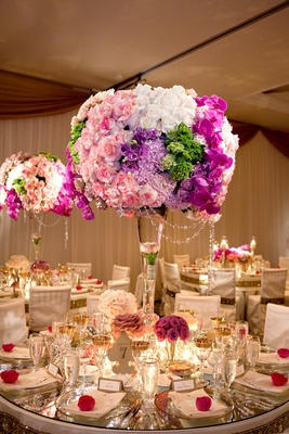 Pink, purple, green, and blue flower centerpiece at reception