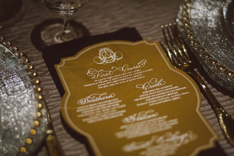White and gold menu card with calligraphy