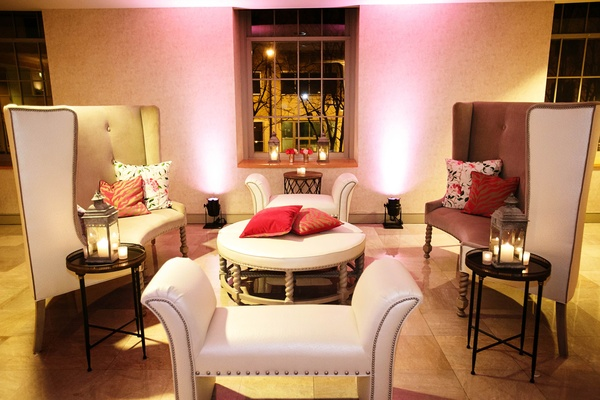 Wedding reception lounge with settees and ottomans