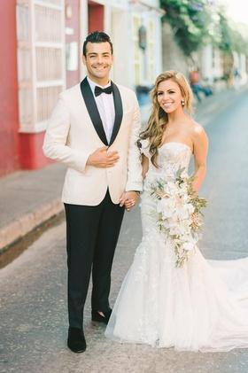 wedding couple in colombia destination wedding groom white tuxedo bride carine's bridal atelier gown